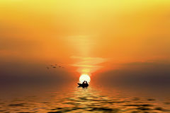 Silhouette of a couple in the boat. When the sun goes down Royalty Free Stock Image