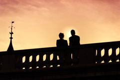 Silhouette of couple on the bridge. At sunset Royalty Free Stock Image