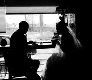Silhouette of the couple in the cafe Stock Image