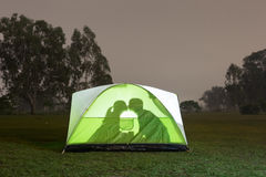 Silhouette of couple camping royalty free stock photography