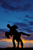 Silhouette couple dance tip back leg out Royalty Free Stock Image