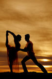 Silhouette couple dancing hands on her waist Royalty Free Stock Image