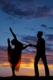 Silhouette couple dancing her lean head back to foot Stock Photos