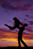 Silhouette couple dancing he lifts her up Stock Images