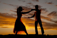 Silhouette couple dancing reach arm out Stock Images