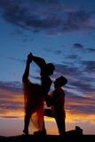 Silhouette couple dancing scorpion kneel Royalty Free Stock Photos