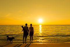Silhouette of a couple and dog Stock Image
