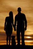 Silhouette of couple with a dog Royalty Free Stock Images