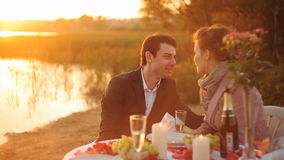 Silhouette of couple drinking champagne at sunset stock footage
