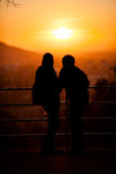 Silhouette of couple enjoying sunset over Freiburg Stock Image