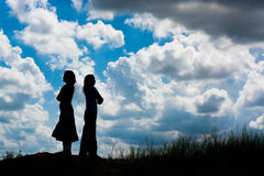 Silhouette couple of girls stand at the park Royalty Free Stock Photography