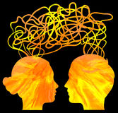 Silhouette of couple heads thinking, relationship. Abstract yellow silhouette of couple heads thinking, relationship concept Stock Photo