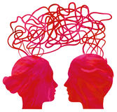 Silhouette of couple heads thinking, relationship Stock Images