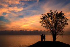 Silhouette couple holding hand Stock Image