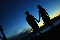 Silhouette of couple holding hands Royalty Free Stock Photo