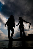 Silhouette of couple holding hands Royalty Free Stock Photography