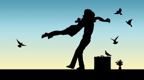 Silhouette of a couple jumping into the arms of each other Royalty Free Stock Images