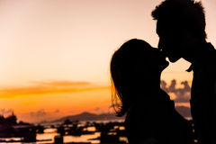 Silhouette of couple kiss on the beach at the sunrise and sunset Stock Photography