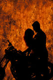 Silhouette couple kiss on motorcycle fire Stock Image