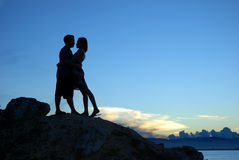 Silhouette of couple kissing Stock Photos