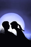 Silhouette of couple in love Stock Image