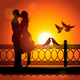 Silhouette of couple in love kissing at sunset. Silhouette of couple in love kissing, vector Eps10 illustration Royalty Free Stock Photography