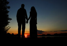 Silhouette of a couple in love royalty free stock photos