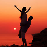 Silhouette couple in love stock image