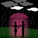 Silhouette couple love with umbrella standing under the rain Royalty Free Stock Photography