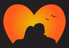 Silhouette couple in love. Who look at the sunset Royalty Free Stock Image