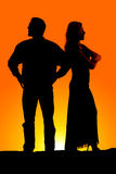 Silhouette Couple Mad Arms Folded Stock Image