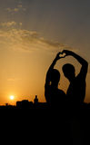 Silhouette of a couple making heart shape Stock Photography