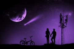 Silhouette couple man and woman holding hand moon night watching a meteor stock images