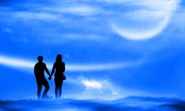 Silhouette couple man and woman holding hand together under moon stock image