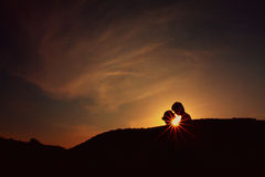 Silhouette of couple. Silhouette of man and woman on the sunset Royalty Free Stock Photo