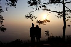 Silhouette of couple man and woman at tree. With sunset background, Wedding love concept Royalty Free Stock Images