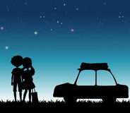 Silhouette couple at night time Royalty Free Stock Image