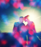 Silhouette couple  over sunset ,heart bokeh background Stock Photography