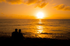 Silhouette of a couple people at sunset. Silhouette of a loving couple at sunset Royalty Free Stock Images