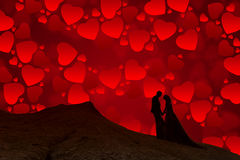Silhouette of couple with red sky full of hearts Stock Photos