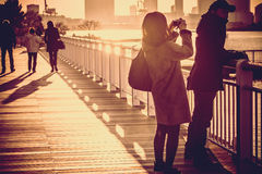 Silhouette of a couple stand selfie on balcony bridge. Royalty Free Stock Image
