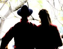 Silhouette of a couple standing on a balcony royalty free stock images