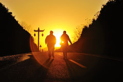 Silhouette couple on the sunset Stock Photography