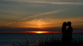 Silhouette of couple at sunset stock video
