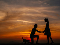 Silhouette of Couple at Sunset Royalty Free Stock Photography