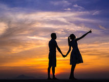 Silhouette of Couple at Sunset Royalty Free Stock Images