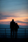 Silhouette of couple in sunset Stock Photo
