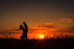 Silhouette of couple at sunset Stock Image