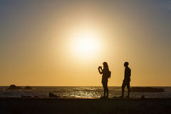 Silhouette of couple taking pictures by the sea. Essaouira, Morocco Royalty Free Stock Image