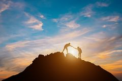 Silhouette of couple teamwork stock photos